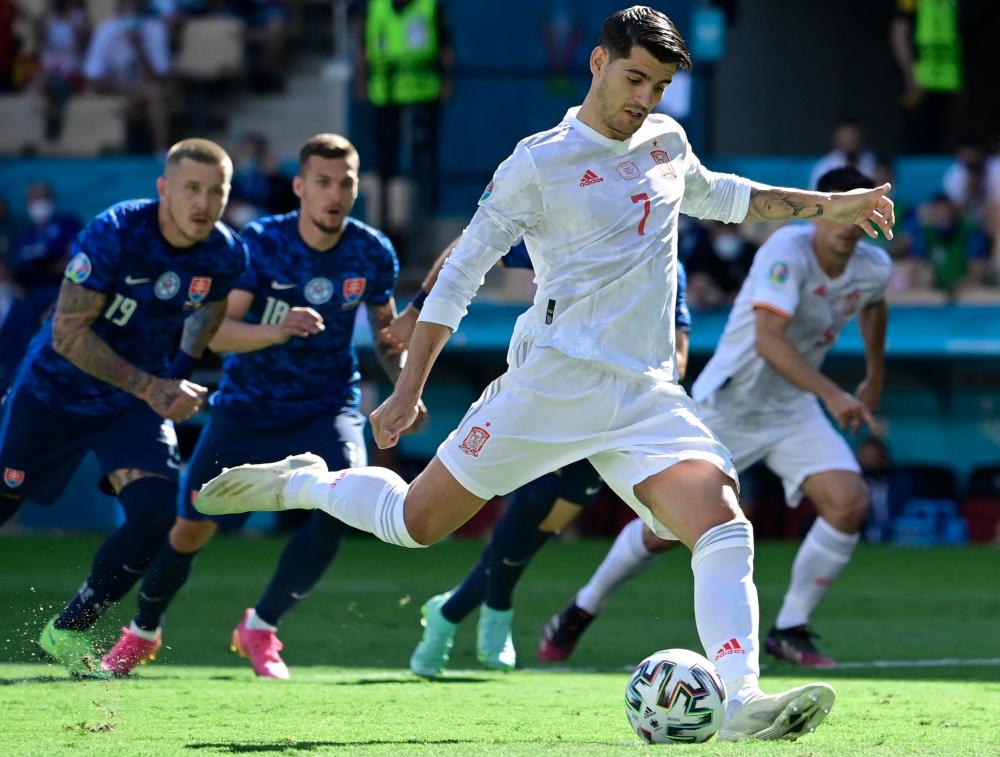 Spain's forward Alvaro Morata kicks the ball during the Uefa Euro 2020 Group E football match between Slovakia and Spain at La Cartuja Stadium in Seville June 23, 2021. — AFP pic