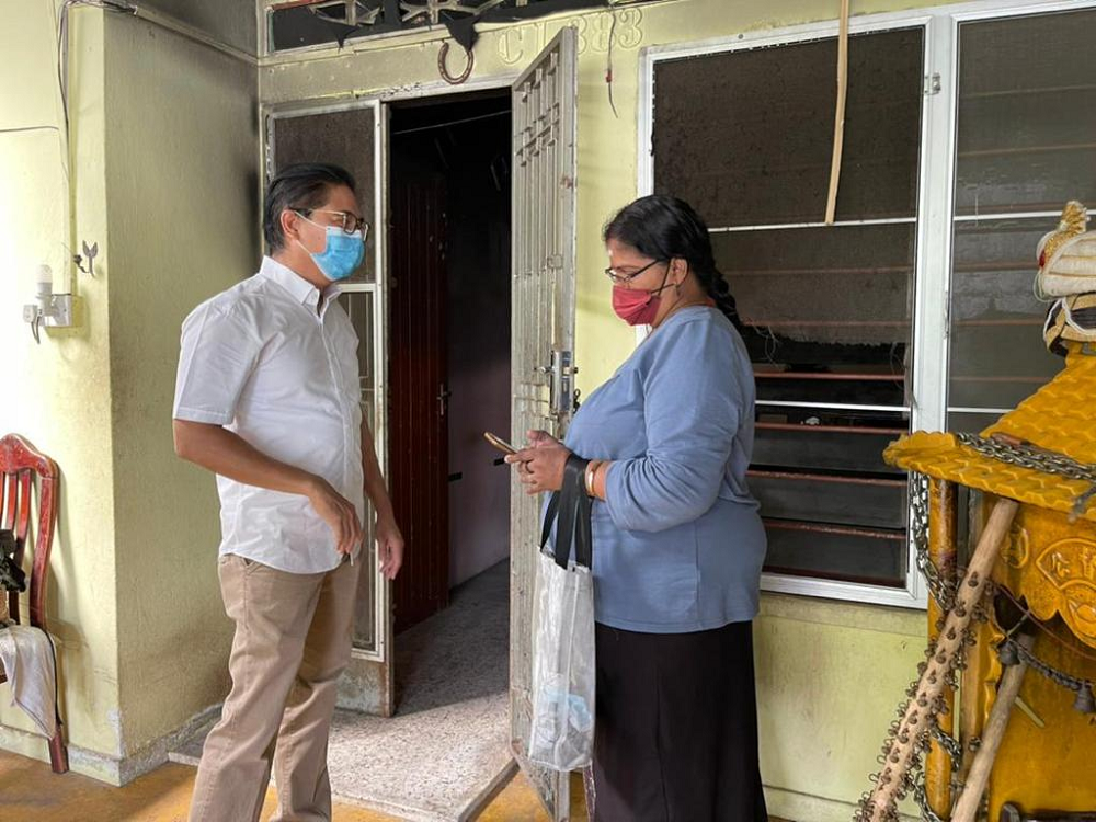 Pasir Bedamar assemblyman Terence Naidu (left) is helping A. Vimala and her family to rebuild their home at Eastern Garden that was destroyed in a fire last Wednesday. ― Picture courtesy of Terence Naidu