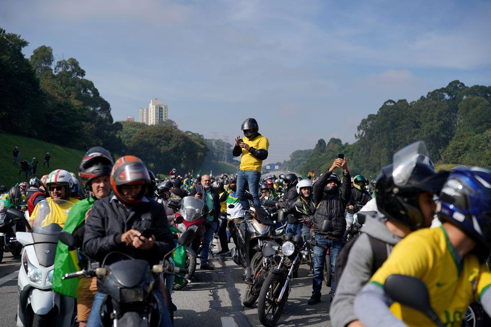 Supporters of Brazil's President Jair Bolsonaro attend a motorcade rally amid the coronavirus disease (Covid-19) pandemic, in Sao Paulo, Brazil June 12, 2021. — Reuters pic