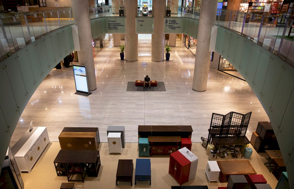 A man sits in an empty mall during the coronavirus disease (Covid-19) pandemic in Singapore May 31, 2021. — Reuters pic