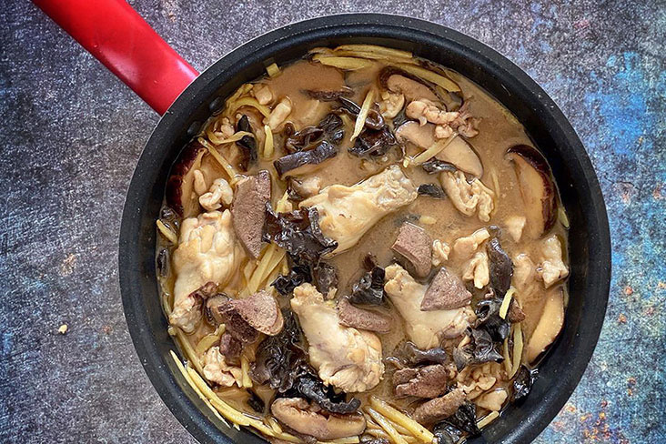 Nothing like a big pot of 'fa tiu zao gai' (flower carving wine chicken) to ward off the downer days. – Pictures by CK Lim