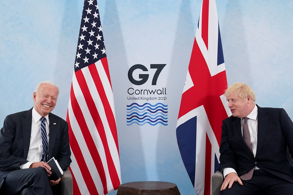 US President Joe Biden laughs while speaking with Britain's Prime Minister Boris Johnson during their meeting, ahead of the G7 summit, at Carbis Bay, Cornwall, Britain June 10, 2021. ― Reuters pic