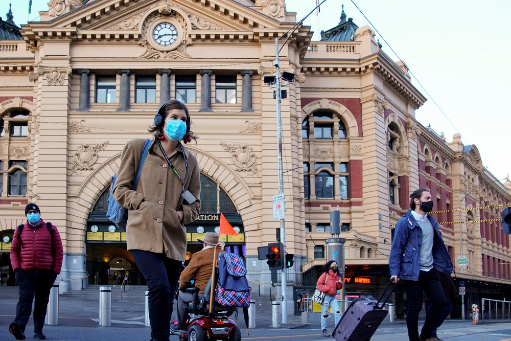 Pedestrians cross the road at Flinders Street Station on the first day of eased Covid-19 restrictions for the state of Victoria following an extended lockdown in Melbourne, Australia June 11, 2021. ― Reuters pic