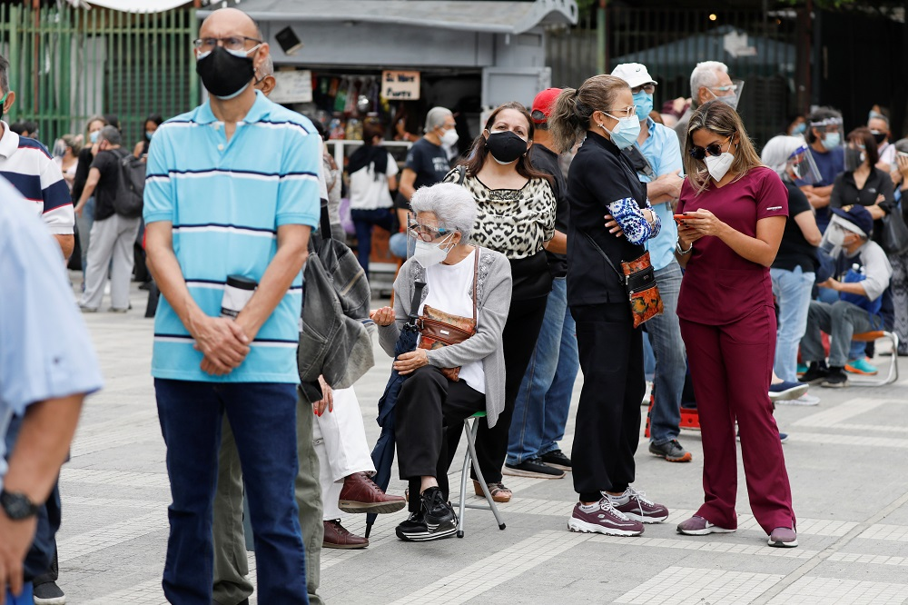 Senior citizens and health workers wait to receive their first dose of Russia's Sputnik V vaccine against Covid-19, outside the hotel Alba Caracas, which was turned into a mass vaccination centre, in Caracas, Venezuela May 31, 2021. ― Reuters pic