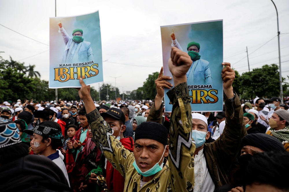 People take part in a protest supporting Rizieq Shihab, an Indonesian Islamic cleric who is sentenced for breaching Covid-19 curbs after his return last year from self-imposed exile, in Jakarta June 24, 2021. ― Reuters pic