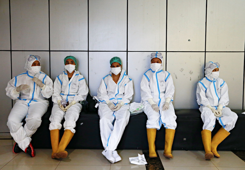 Healthcare workers wearing personal protective equipment get ready to treat patients at the emergency hospital for the coronavirus disease, in Jakarta, Indonesia, June 17, 2021. — Reuters pic