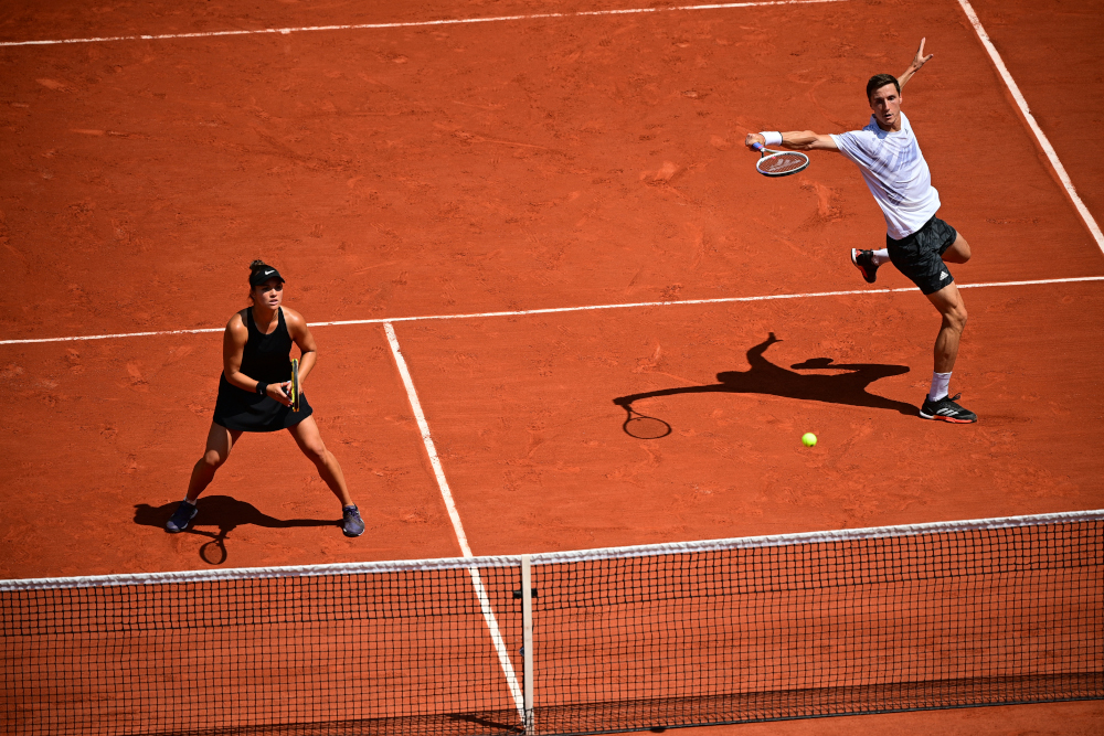 Britain's Joe Salisbury and Desirae Krawczyk of the US return the ball to Russia's Elena Vesnina and Russia's Aslan Karatsev during their mixed doubles final tennis match on Day 12 of The Roland Garros 2021 French Open tennis tournament in Paris June 10, 2021. — AFP pic