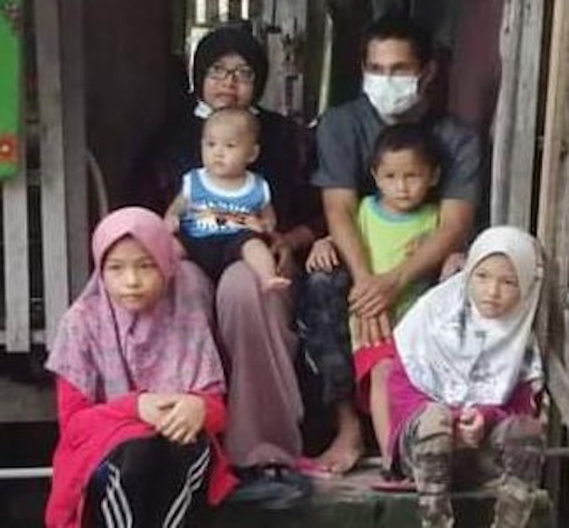 Siti Meriam, Mohd Khairi and their children had been eating plain fried rice and biscuits since the start of the pandemic. — Picture by Siti Meriam Mohamad