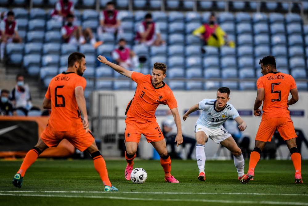 Netherlands' defender Matthijs De Ligt vies with Scotland's forward Che Adams during the international friendly football match at the Algarve stadium in Faro, in preparation for the Uefa European Championships, June 2, 2021. — AFP pic