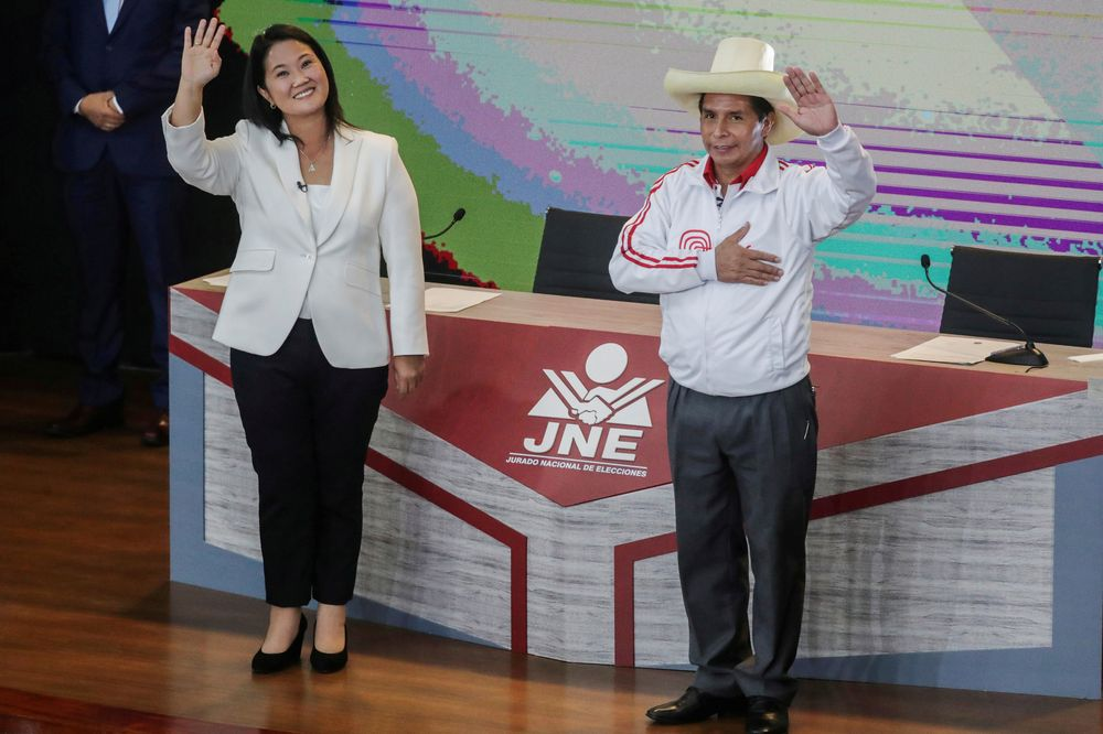 Peru's right-wing candidate Keiko Fujimori and socialist candidate Pedro Castillo wave at the end of their debate ahead of the June 6 run-off election, in Arequipa, Peru, May 30, 2021. — Reuters pic