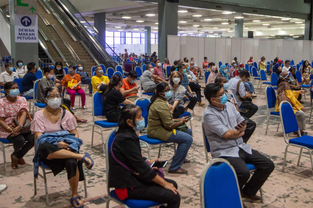 People wait to receive their Covid-19 vaccines at the Covid-19 vaccination centre in the Mines International Exhibition and Convention Centre, Seri Kembangan, June 17, 2021. — Picture by Shafwan Zaidon