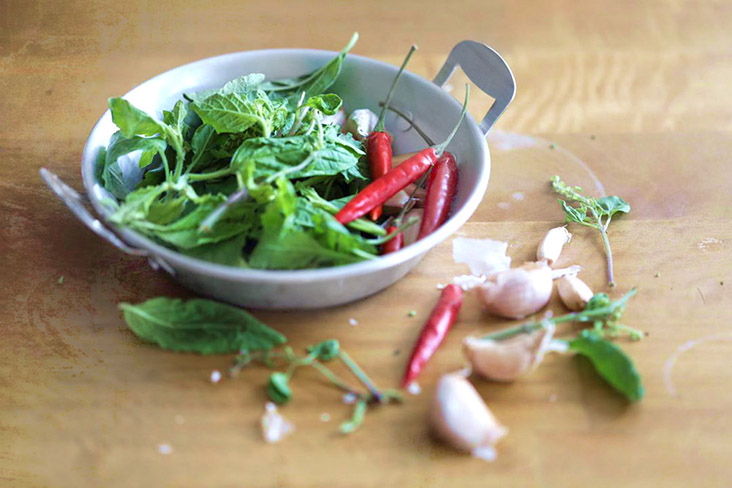 Pair the 'krapao' leaves with indispensable aromatics such as garlic and chillies.