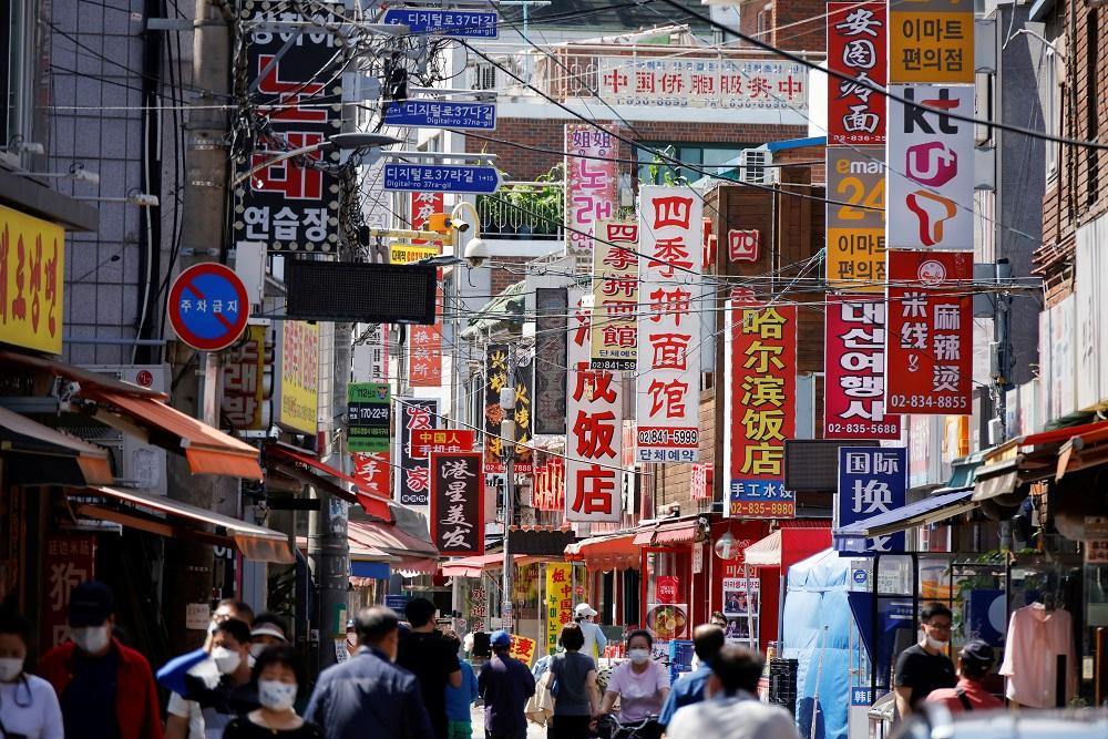 Residents walk in Seoul's Chinatown neighbourhood, June 16, 2021. ― Reuters pic