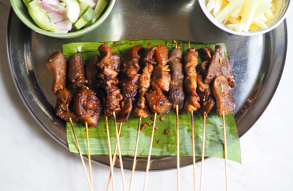 Try a new eating experience with this head to tail pork satay from SS2's Chef V Kor. — Pictures by Lee Khang Yi