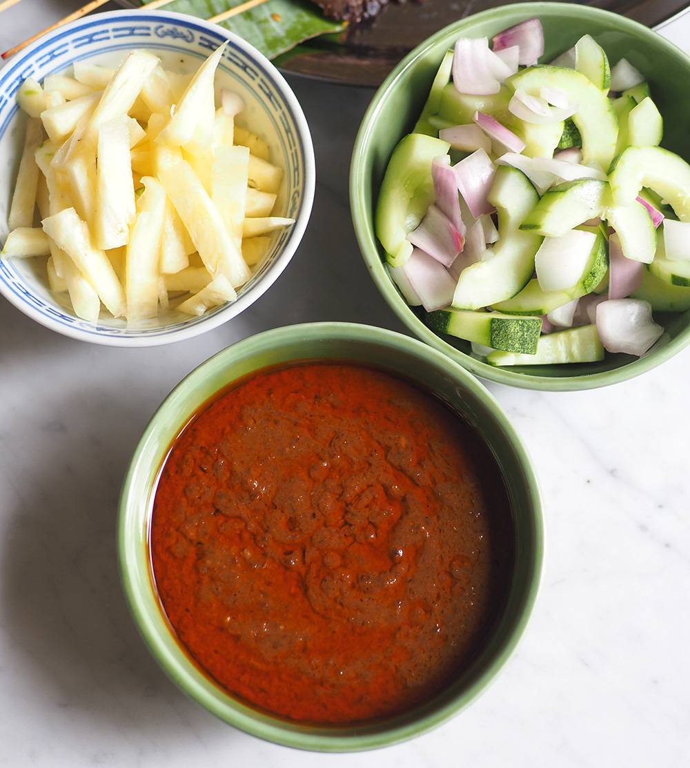 Your order is accompanied with sliced cucumbers, onions and fresh pineapples.