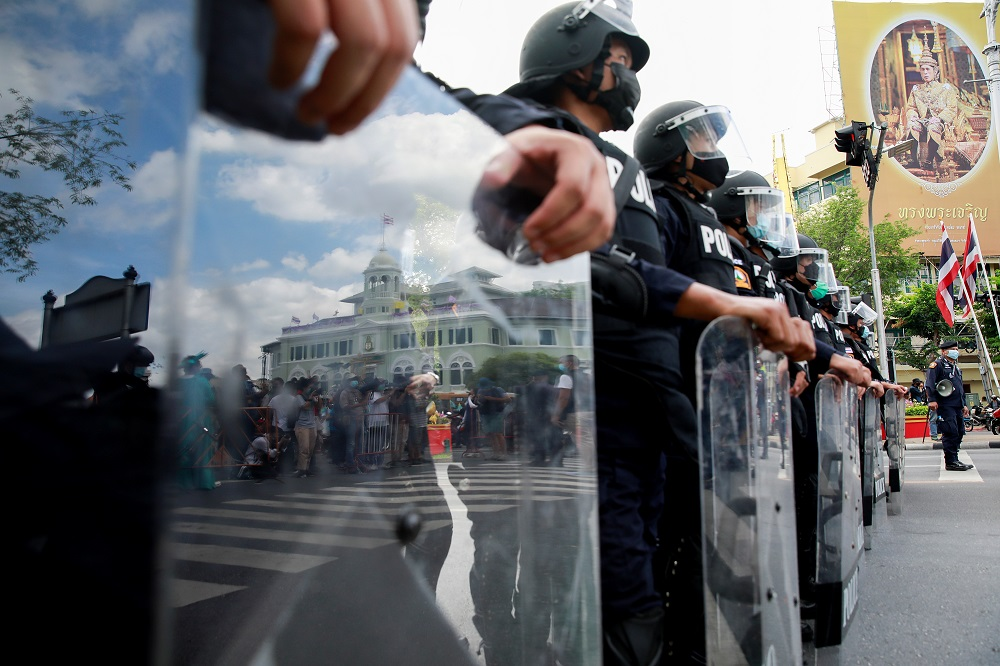 Police stand guard during a demonstration to mark the 89th anniversary of the abolition of absolute monarchy in Bangkok June 24, 2021. ― Reuters pic