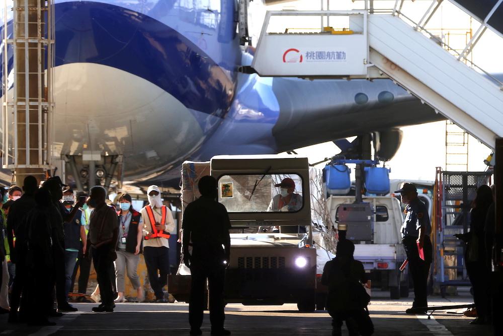 Workers transport Moderna vaccines against the coronavirus disease to Taiwan Air cargo Terminal in Taoyuan, Taiwan, June 18, 2021. — Reuters pic