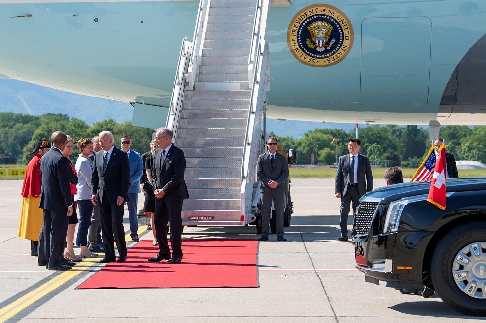 US President Joe Biden meets Swiss delegation members next to Swiss Federal President Guy Parmelin after Biden's arrival at the airport in Geneva, one day prior to the US-Russia summit, in Switzerland June 15, 2021. ― Pool via Reuters