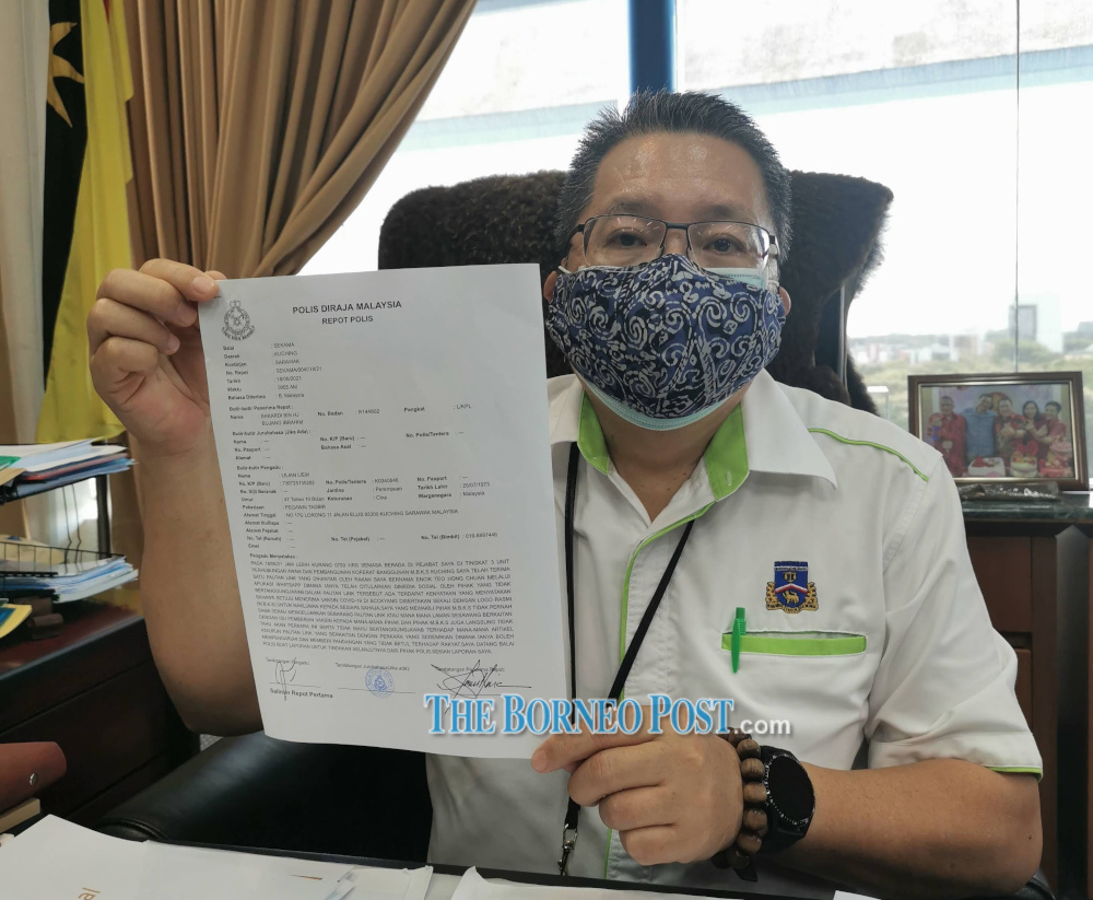 Kuching South mayor Datuk Wee Hong Seng shows the police report. — Borneo Post Online pic