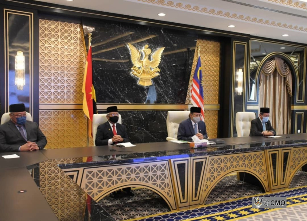 Abang Johari (second right) with (from left) Tiong, Masing and Dr Sim seen during the video conferencing with the King. — Picture courtesy of Chief Minister's Office via Borneo Post Online