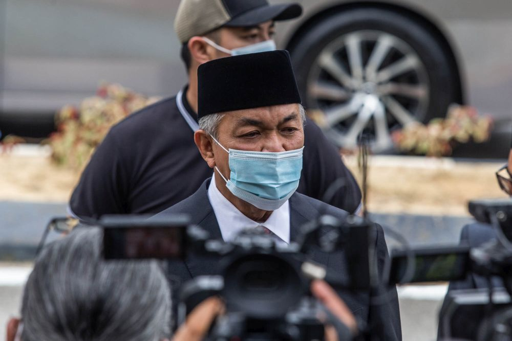 File picture shows Umno president Datuk Seri Ahmad Zahid Hamidi speaking to members of the press outside Istana Negara in Kuala Lumpur June 11, 2021. — Picture by Firdaus Latif
