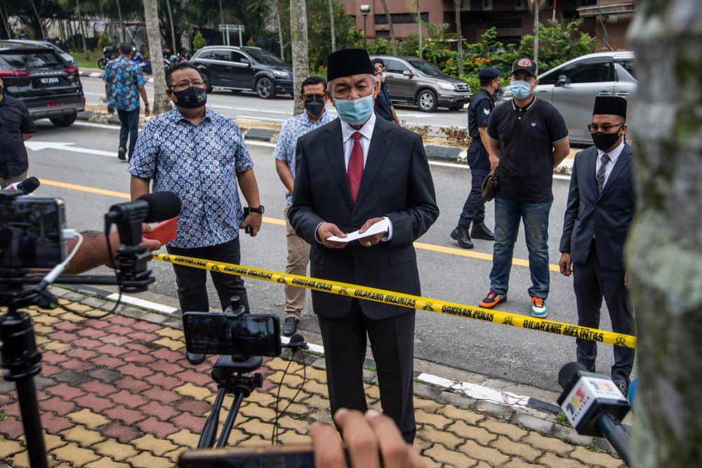Umno president Datuk Seri Ahmad Zahid Hamidi speaks to members of the press outside Istana Negara in Kuala Lumpur June 11, 2021. — Picture by Firdaus Latif