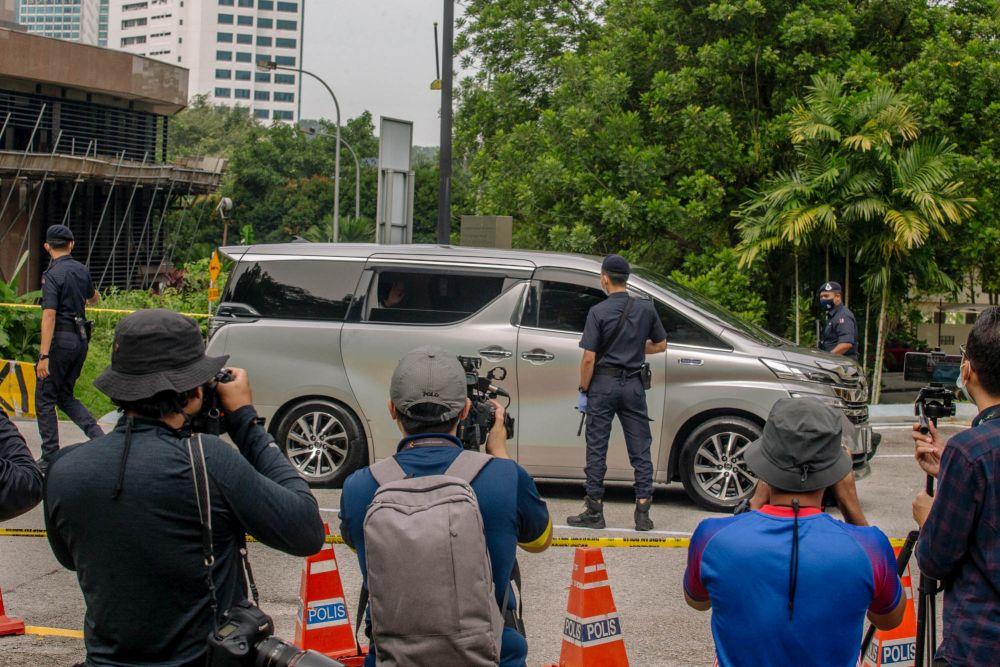 Umno president Datuk Seri Ahmad Zahid Hamidi waves at reporters as he arrives at Istana Negara in Kuala Lumpur June 11, 2021. — Picture by Firdaus Latif