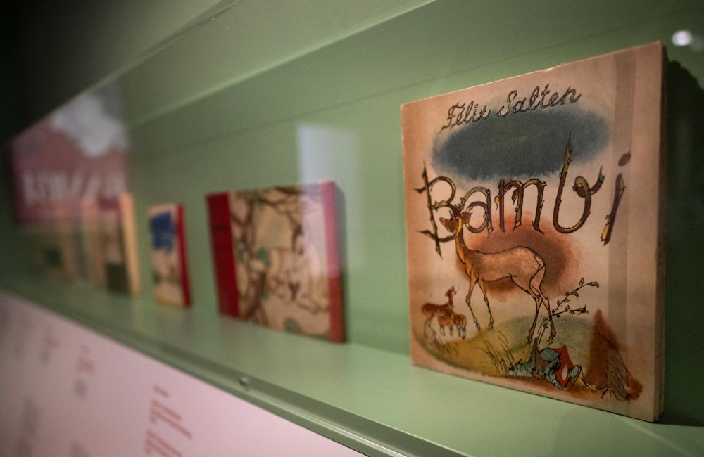 Various translations of the iconic tale 'Bambi: A Life In The Woods' by Felix Salten are seen on display at the City Hall Library in Vienna on March 23, 2021. — AFP pic