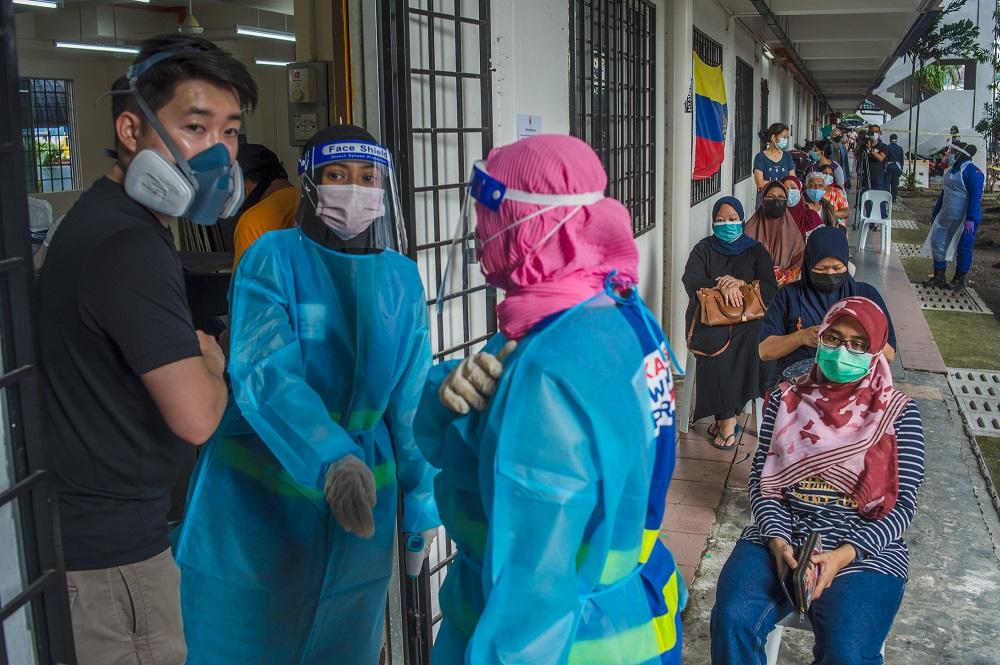 Health workers conduct a Covid-19 swab test in Bandar Tun Razak, Kuala Lumpur June 5, 2021. ― Picture by Shafwan Zaidon