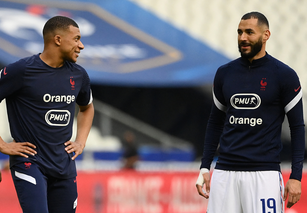 France's forwards Karim Benzema and Kylian Mbappe warm up before the friendly football match between France and Bulgaria at Stade De France in Saint-Denis, on the outskirts of Paris June 8, 2021, ahead of the Uefa Euro 2020 European Championships. — AFP pic