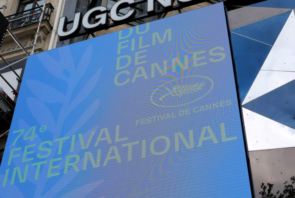 The official logo with a Palme d'Or symbol is seen on a screen in front of a cinema before the presentation of the official selection of the 74th Cannes International Film Festival in Paris, France, June 3, 2021. — Reuters pic