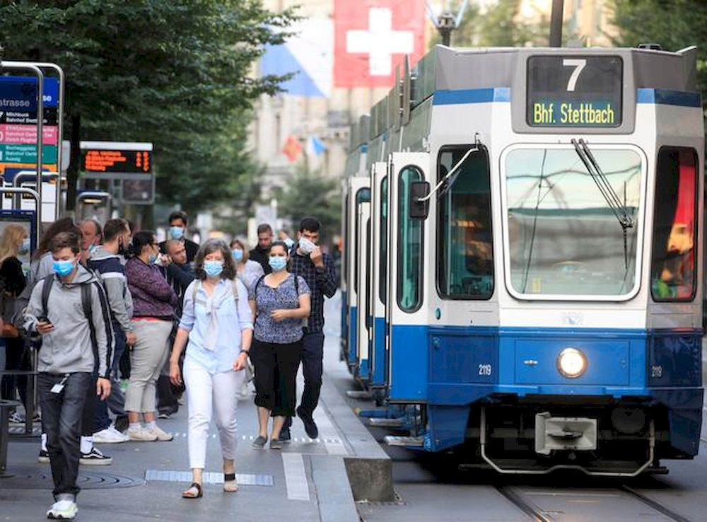 Passengers wear protective masks as they leave a tram of public transport operator Verkehrsbetriebe Zurich (VBZ), as the coronavirus disease (Covid-19) outbreak continues, in Zurich, Switzerland July 6, 2020. — Reuters pic