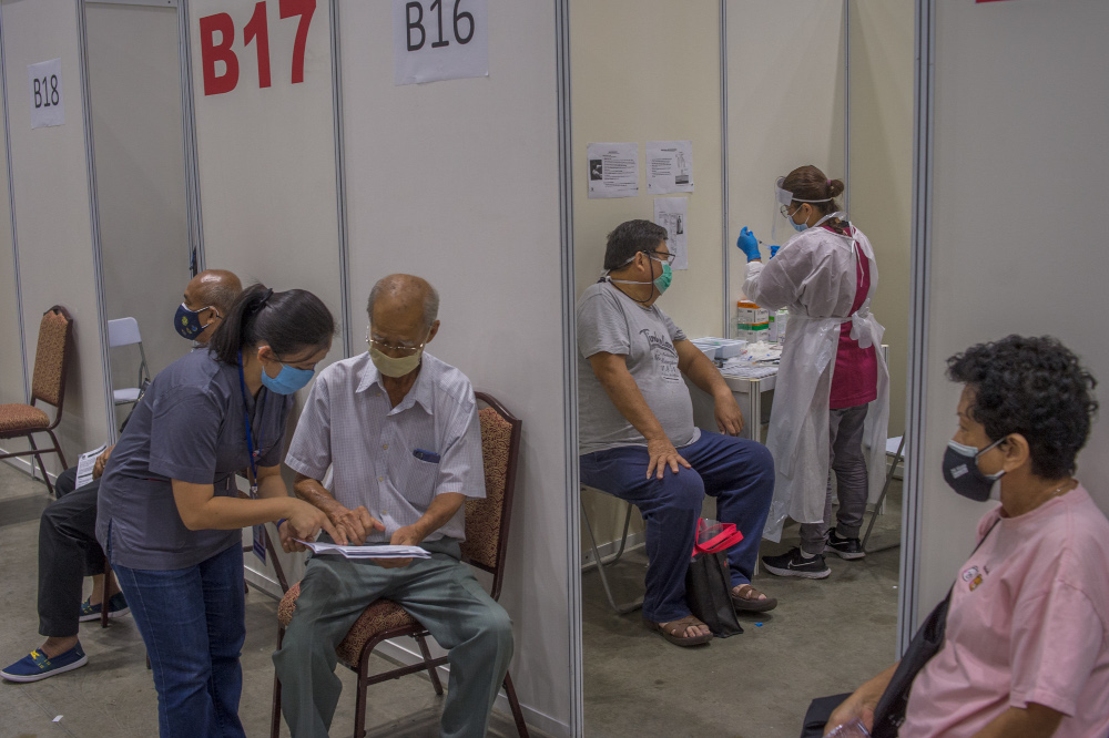 People receive their Covid-19 vaccines during the National Covid-19 Immunisation Programme at Kuala Lumpur Convention Centre in Kuala Lumpur June 8, 2021. — Picture by Shafwan Zaidon
