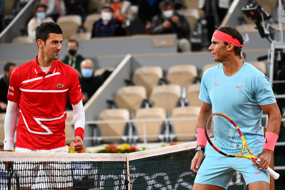 In this file photo taken October 11, 2020 Spain's Rafael Nadal and Serbia's Novak Djokovic talk prior to their men's final tennis match at the Philippe Chatrier court at The Roland Garros 2020 French Open tennis tournament in Paris. — AFP pic