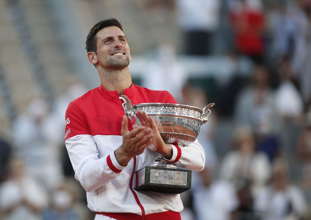 Serbia's Novak Djokovic celebrates with the trophy after winning the French Open against Greece's Stefanos Tsitsipas at Roland Garros, Paris June 13, 2021. — Reuters pic