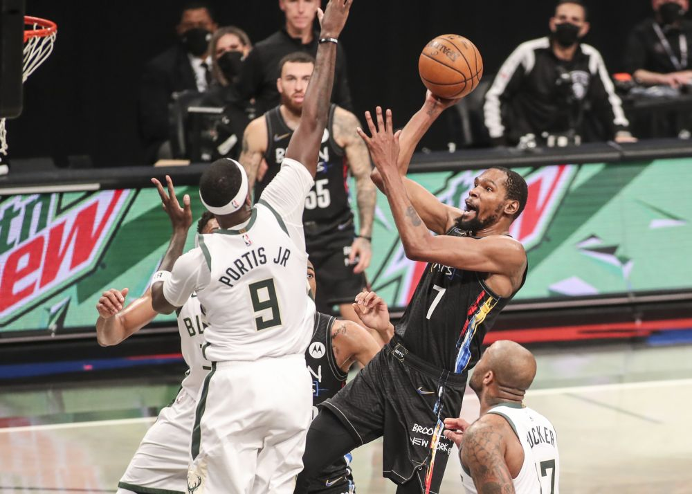 Brooklyn Nets forward Kevin Durant (7) shoots over Milwaukee Bucks centre Bobby Portis (9) in the third quarter during game two in the second round of the 2021 NBA Playoffs June 7, 2021. — Reuters pic