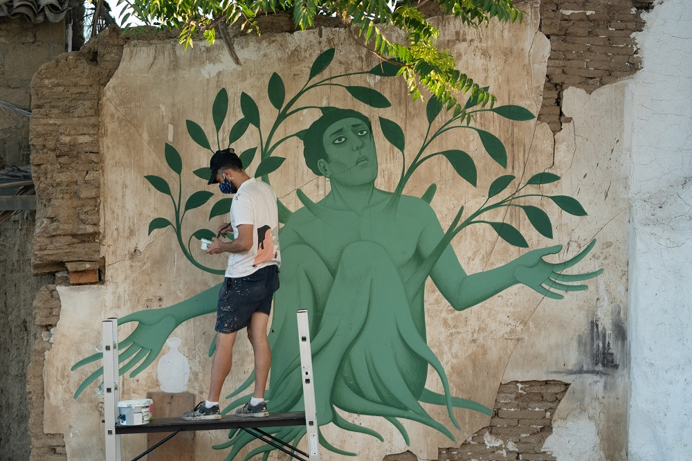 Greek artist Fikos, who describes himself as a 'neo-muralist,' works on one of his murals in the Cypriot capital Nicosia. ― AFP pic via ETX Studio
