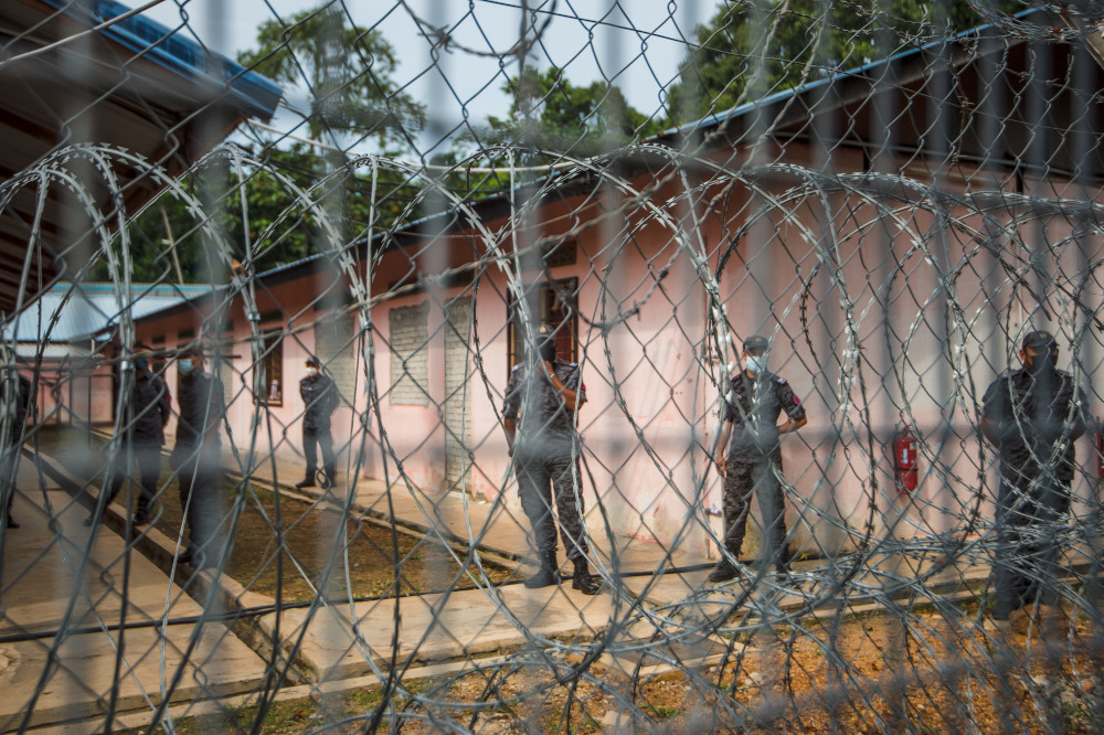Immigration officers guarding the Beranang Satellite Prison and Immigration Depot in Beranang, June 3, 2021. — Picture by Shafwan Zaidon