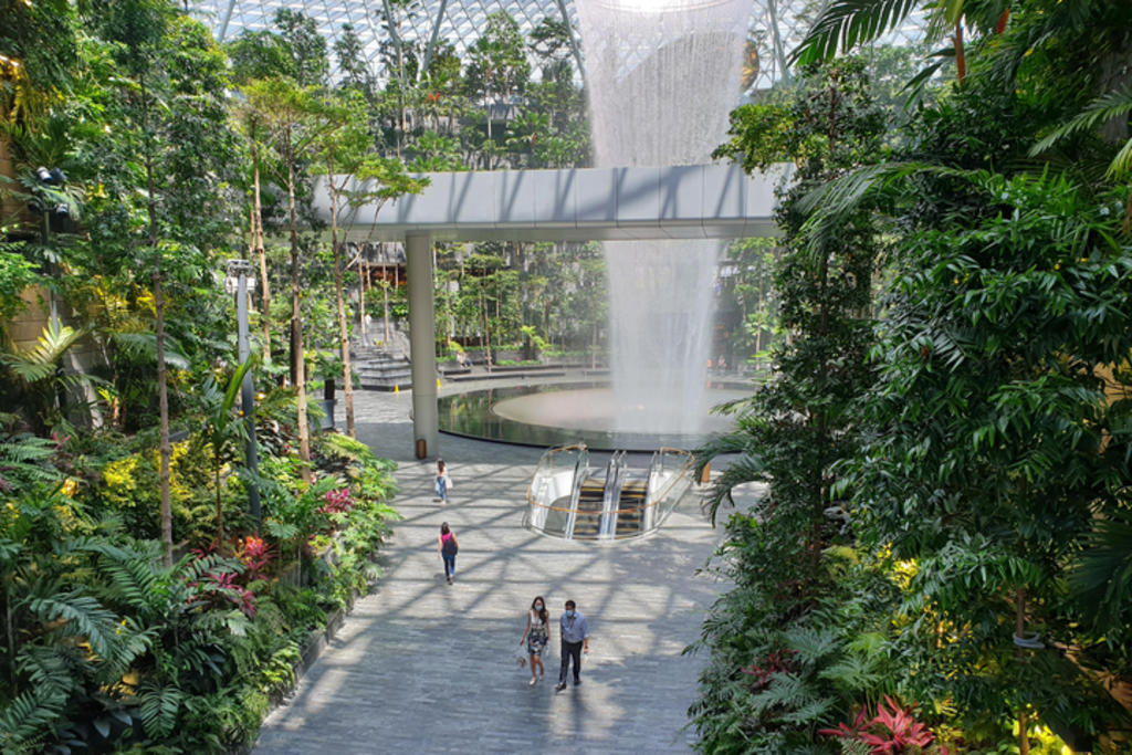 Not many people were at Jewel Changi Airport, including the Rain Vortex waterfall (pictured), when TODAY visited on June 14, 2021, the first day of its reopening after a month-long closure. ― TODAY pic