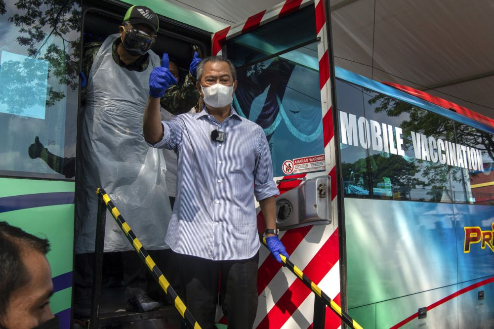 Prime Minister Tan Sri Muhyiddin Yassin is seen during a visit to the mobile vaccination centre at the Sri Johor People's Housing Project in Bandar Tun Razak, Kuala Lumpur June 13, 2021. — Bernama pic