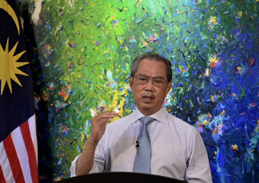 Prime Minister Tan Sri Muhyiddin Yassin delivers his speech on the National Recovery Plan: Transition Phase of MCO in Stages, in Kuala Lumpur, June 15, 2021. — Bernama pic
