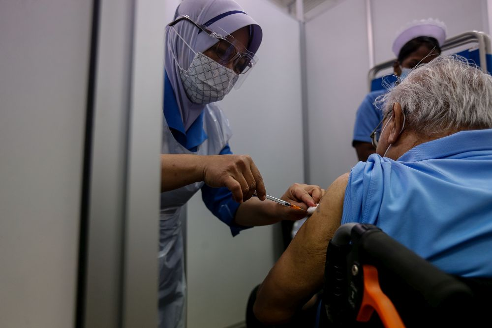 A nurse administers a dose of the Covid-19 vaccine at Pesta Penang, Bayan Lepas June 8, 2021. — Picture by Sayuti Zainudin