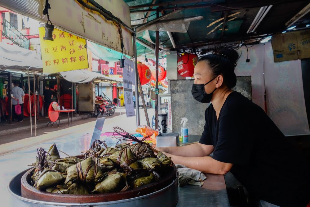 Chong Yoke Yean is seen here at the Ho Yoke Kee stall, which sells multiple varieties of rice dumplings with different fillings. — Picture by Shafwan Zaidon