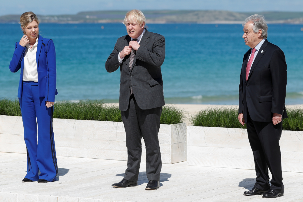 Britain's Prime Minister Boris Johnson and his spouse Carrie Johnson stand next to United Nations Secretary General Antonio Guterres during an official welcome at the G7 summit in Carbis Bay June 12, 2021. — Reuters pic