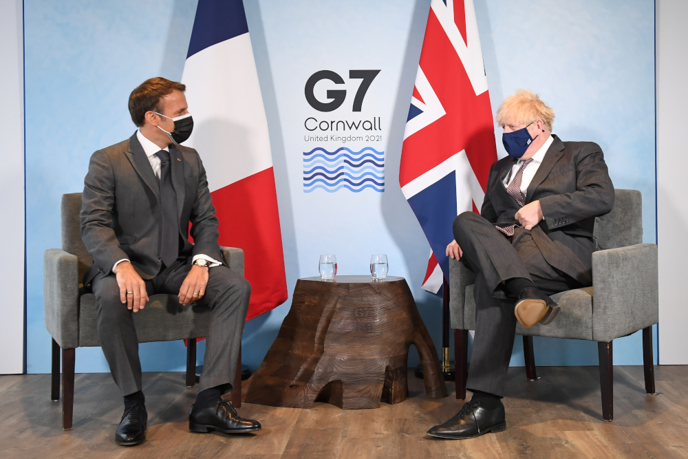 Britain's Prime Minister Boris Johnson and France's President Emmanuel Macron attend a bilateral meeting during G7 summit in Carbis Bay, Cornwall June 12, 2021. — Reuters pic