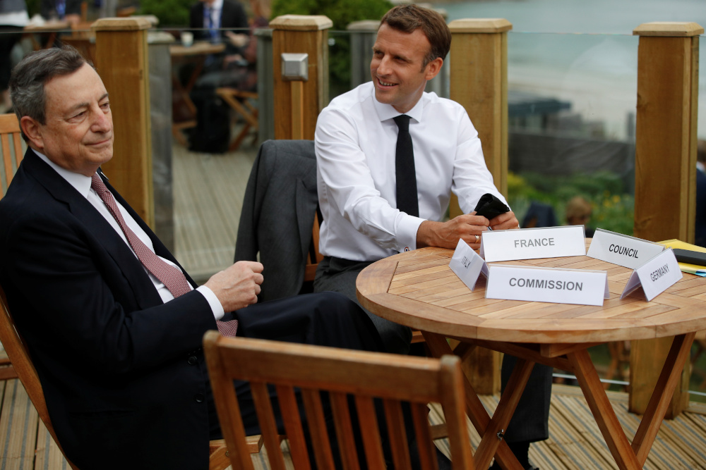 France's President Emmanuel Macron and Italy's Prime Minister Mario Draghi attend an EU coordination meeting at the G7 summit in Carbis Bay, Cornwall June 11, 2021. — Reuters pic
