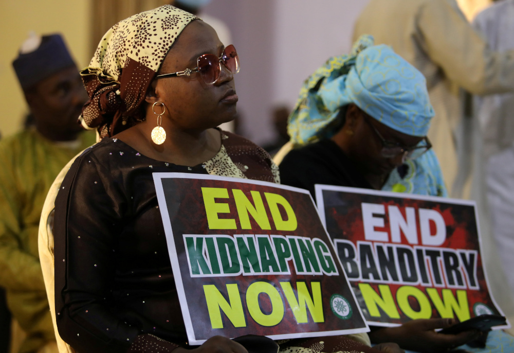 A demonstrator holds a sign during a protest to urge authorities to rescue hundreds of abducted schoolboys, in north-western state of Katsina, Nigeria, December 17, 2020. — Reuters pic