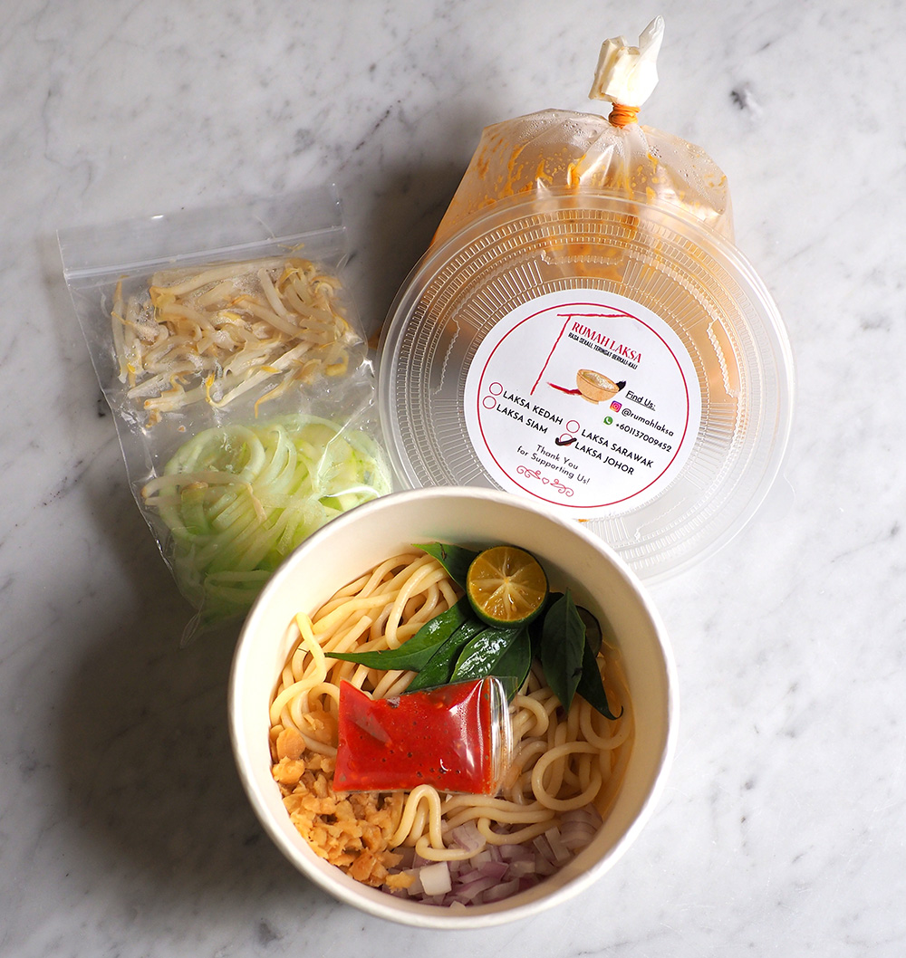 The condiments, pasta and broth are all neatly packed for the Johor laksa.