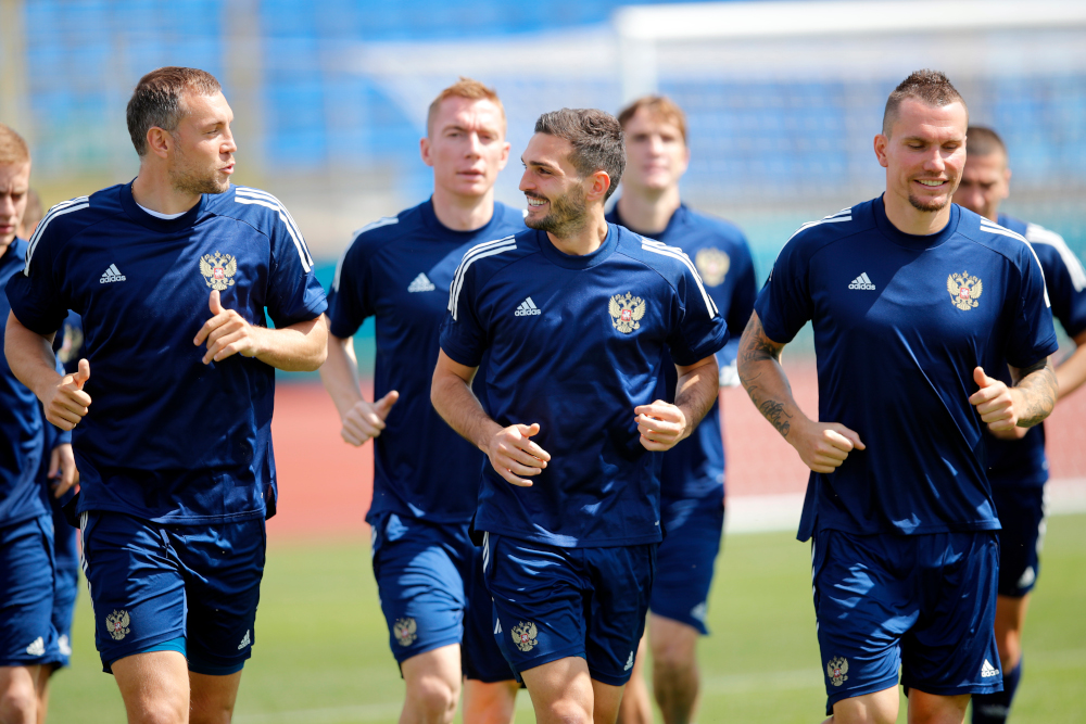 Russia's Artem Dzyuba and Magomed Ozdoyev with teammates during training at the Petrovskly Stadium, Saint Petersburg, Russia, June 11, 2021. — Reuters pic