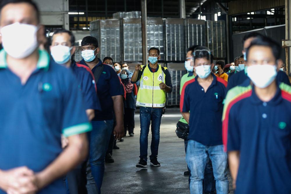 Enforcement officers conduct SOP spot checks on a factory in Mak Mandin, Penang, June 23, 2021. — Picture by Sayuti Zainudin
